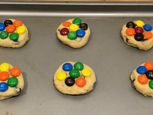 Add M&Ms to top of the cookie dough patties